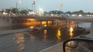 Car Takes on Flooded Underpass in Reverse