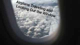 Airplane Traveling and Looking Out the Window