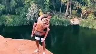 Three people doing awesome cliff jump