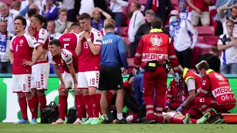 Denmark soccer player 'awake' after collapsing