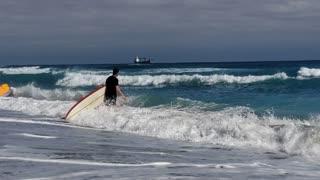 Surfers enjoy a beautiful day - Atlantic Ocean, Palm Beach, Florida
