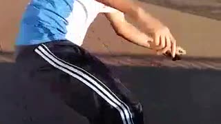 Black hat guy tries to skateboard on wooden half pipe