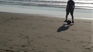 Riding one wheel board on beach