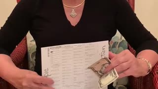 Woman offered 5 USD to vote for Biden