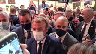 Protester throws egg at Macron, shouts 'Vive la revolution'