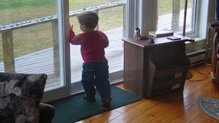 Kid takes pride in his window cleaning