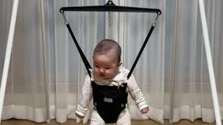 Baby practicing walking.