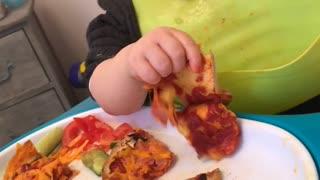 Sleepy Baby Enjoys Pizza