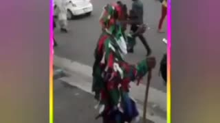 Dopey man dancing in the city