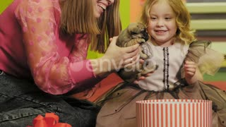 Happy Little Girl Got a Puppy for Her Birthday