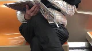 Old man reading magazine picking nose