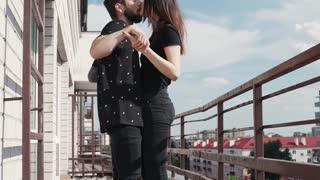 Couple Dancing and Kissing at Balcony