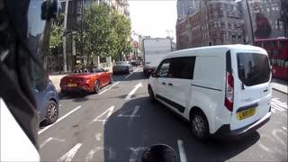Van Nearly Sideswipes Motorcyclist