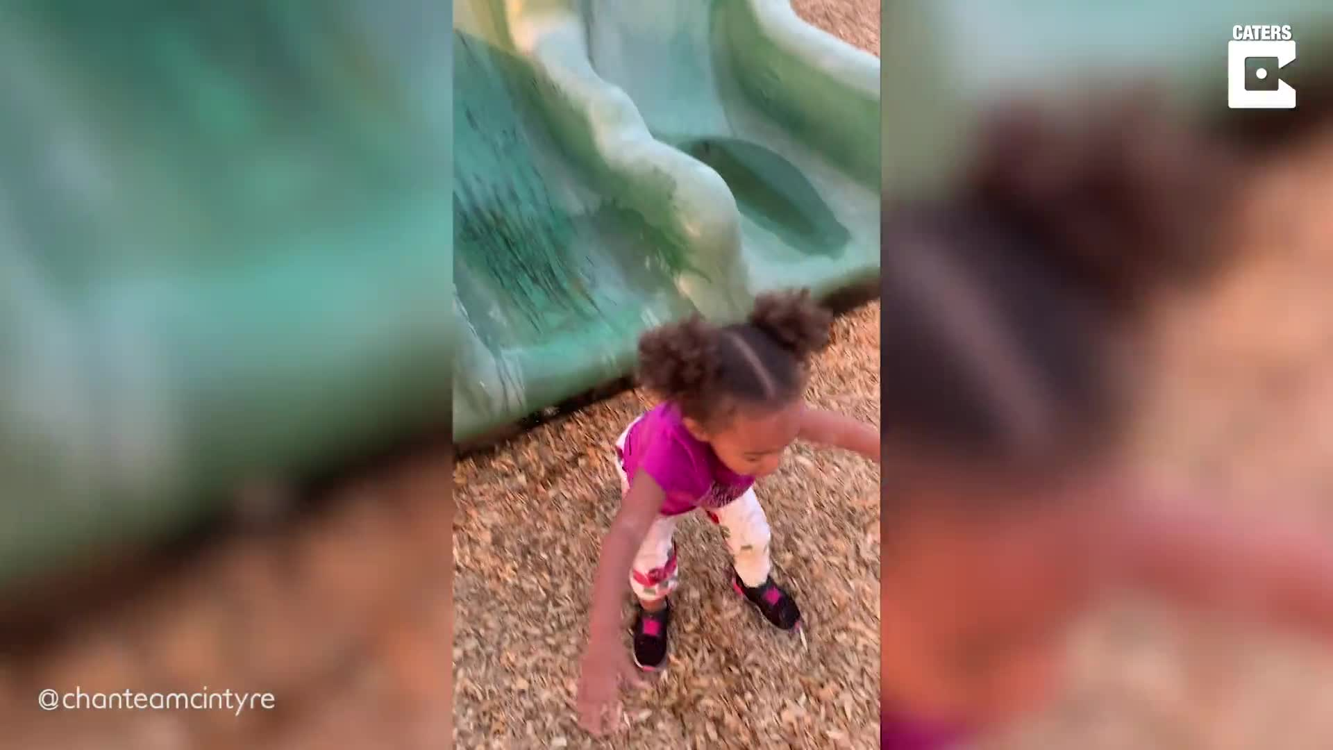 NOT THE IDEAL WATER SLIDE: LITTLE GIRL SLIDES STRAIGHT INTO A PUDDLE OF WATER
