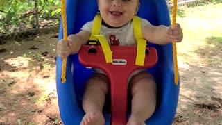 Baby B swinging