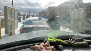 Canadian Clears Off Snow Covered Car