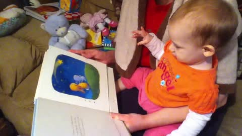 Emma being read to