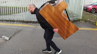 Guy carries 400lb Piano to band practice