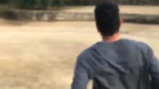 Guy runs and does backflip, kicks person holding camera