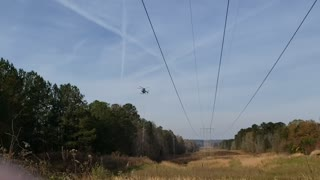 Helicopter mows the trees
