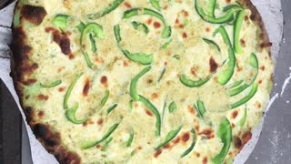 Green Pizza with pesto Alfredo sauce and Green Sweet peppers