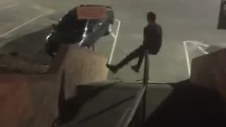 Guy sliding down night stairs spins all the way around rail
