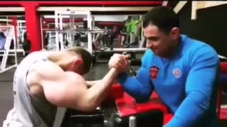 Man with big biceps arm wrestling