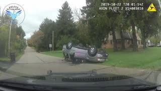 Police Dashcam Captures Rollover Crash During Chase