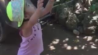 Lisa gets a delicious fruit season. Little girl farmer