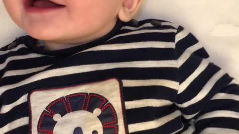 How cute baby boy giggles