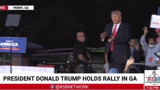 Trump walks out to a raucous crowd for his rally in Perry, Georgia
