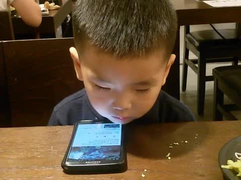 Tired toddler struggles to stay awake