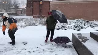 Playing snow with my friend