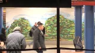Man hypes up dancer inside of subway station