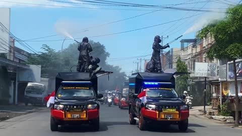 Police Officers Sprays Disinfectant on Makassar Street