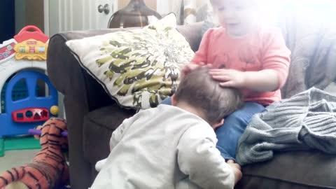 Baby Siblings Playing