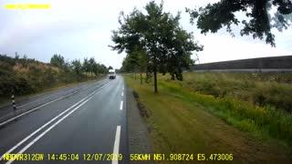 Car U-Turns into Oncoming Traffic