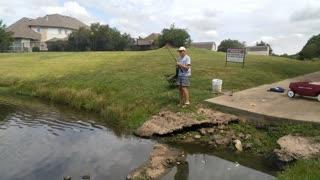 Catching a large catfish from a local pond.