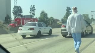 Mentally Ill Man in Bandages Walks on Highway