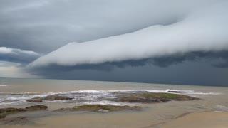 Intense Stormcloud Sweeps Across Sea