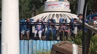 Enjoying at theme park ride