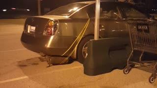 Muffler Tied Down Through Car Window