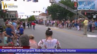 Carrollton PD Sergeant Rob Holloway Returns Home.