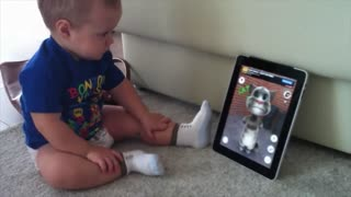 See baby playing with phone