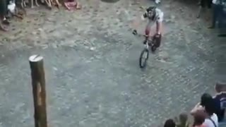 Riding a bicycle on a tree stump...