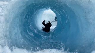 Sliding Through Glacial Ice Cave