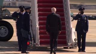 President Biden stumbles while boarding