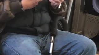 Older man clipping nails subway