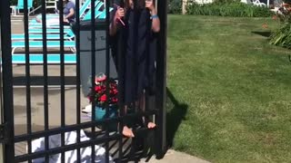 Daughter Struggles to Keep Gate Open