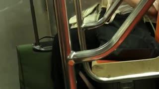 Woman goggles fixing bra on subway